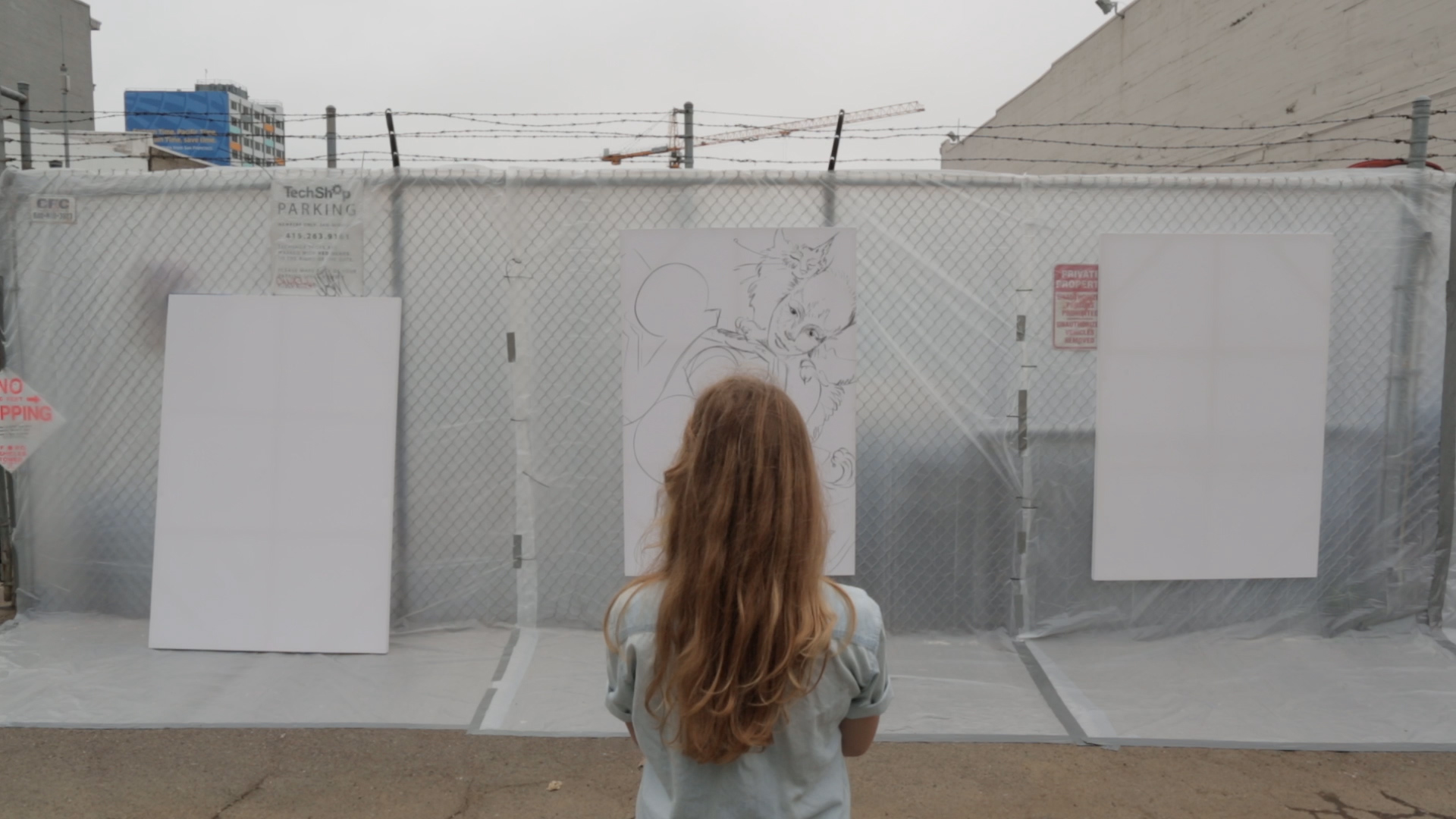 An activist contemplates her next step at the 2012 Urban Prototyping Festival.